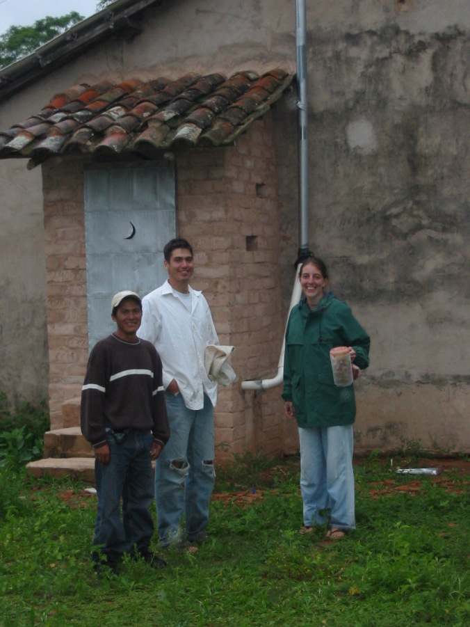 The  happy family with their new latrine (Jaun, Stan, and Tricia)