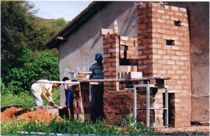 Constructing the latrine with rammed earth blocks