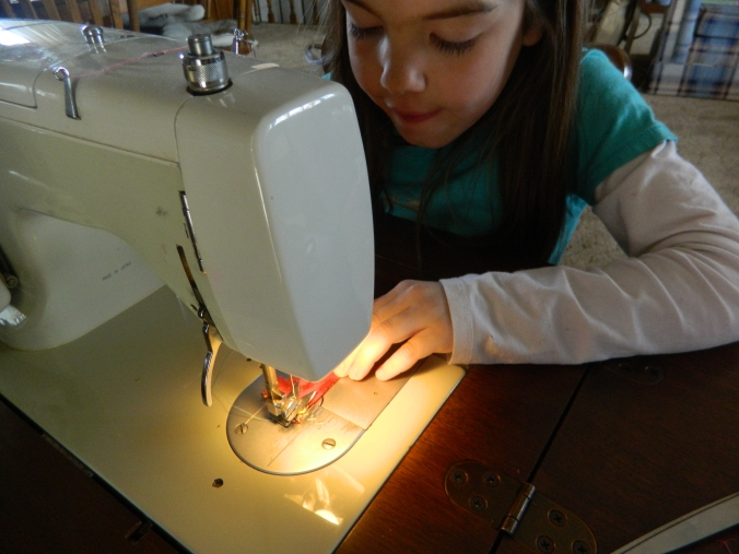 Grandma taught both girls how to sew on their own!