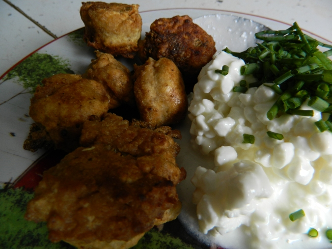 Dandelion fritters with chives and cottage cheese.